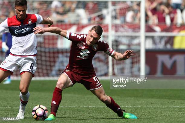 Torino forward Andrea Belotti fights for the ball against Crotone midfielder Lorenzo Crisetig during the Serie A match between FC Torino and FC...