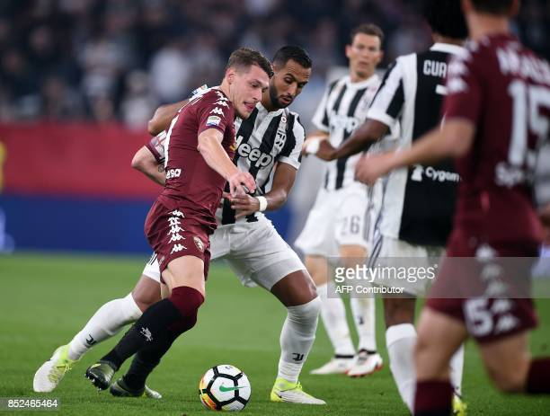 Torino italian forward Andrea Belotti vies with Juventus's defender from France Medhi Benatia during the Italian Serie A football match Juventus vs...