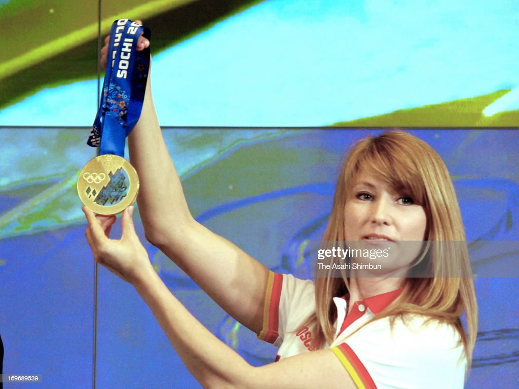 Torino Olympic Women's short track 500m gold medalist Svetlana Zhurova unveils the Sochi Olympic gold medal during the SportAccord International Covention on May 30, 2013 in St. Petersburg, Russia.