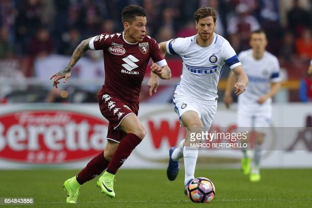 Torino's Argentinian forward Juan Manuel Iturbe vies for the ball with Inter Milan's Argentinian defender Cristian Ansaldi during the Italian Serie A...