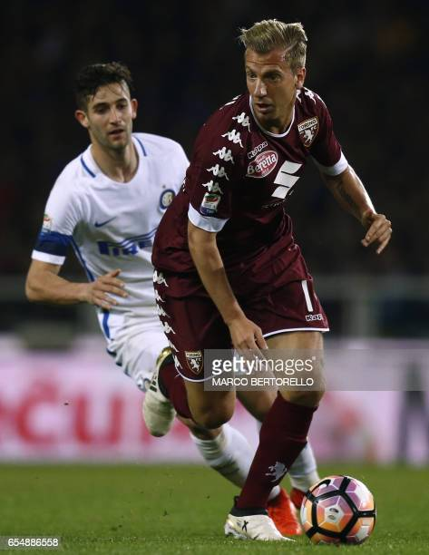 Torino's Argentinian forward Maxi Lopez viess for the ball with Inter Milan's midfielder Roberto Gagliardini during the Italian Serie A football...