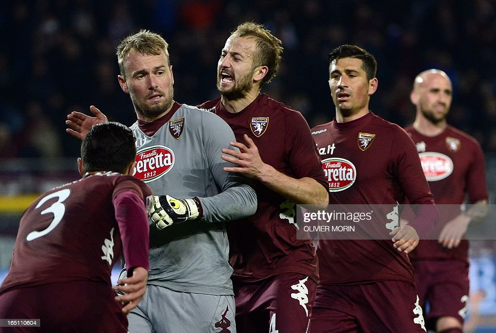 Torino's Belgium goalkeeper Jean Francois Gillet is congratulated by teammates after saving a penalty shot during the serie A football match between Turin and Naples, on March 30, 2013 in Turin, at the Olympic stadium . AFP PHOTO / OLIVIER MORIN