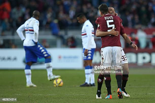 Torino's Brazilian defender Bruno Peres celebrates after scoring with teammate Torino's defender Cesare Bovo during the Italian Serie A football...