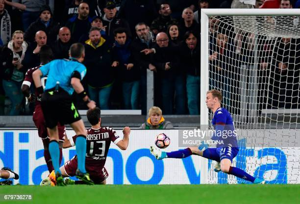 Torino's British goalkeeper Joe Hart stops the ball during the Italian Serie A football match Juventus vs Torino FC at the Juventus stadium in Turin...