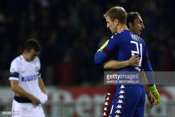 Torino's British midfielder Joe Hart celebrates with Torino's defender Cristian Molinaro after the Italian Serie A football match Torino versus Inter...