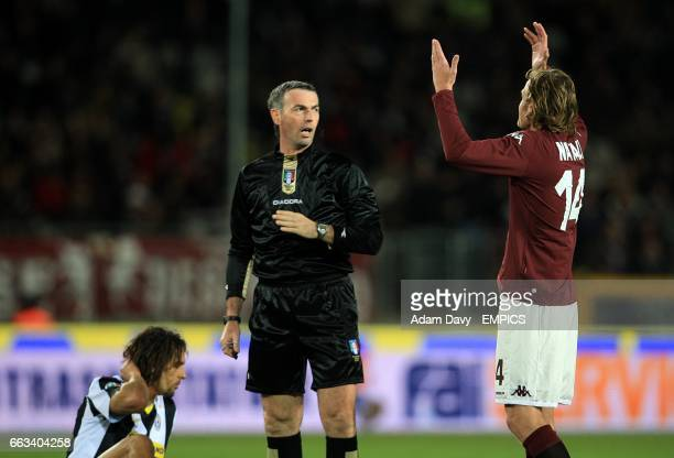 Torino's Cesare Natali appeals to referee Stefano Farina after a foul on Juventus' Carvalho De Oliveira Amauri