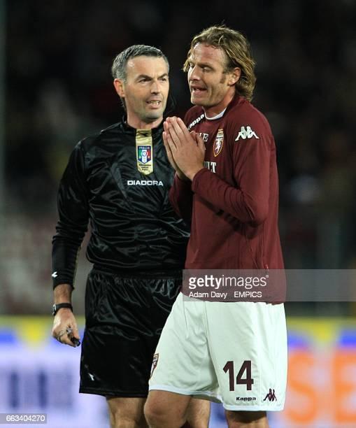 Torino's Cesare Natali appeals to referee Stefano Farina