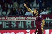 Torino's defender Cristian Molinaro celebrates after scoring a goal during the UEFA Europa League football match Torino vs Helsinki on October 23...