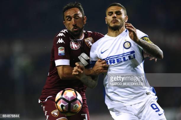 Torino's defender Cristian Molinaro vies with Inter Milan's Argentinian forward Mauro Emanuel Icardi during the Italian Serie A football match Torino...