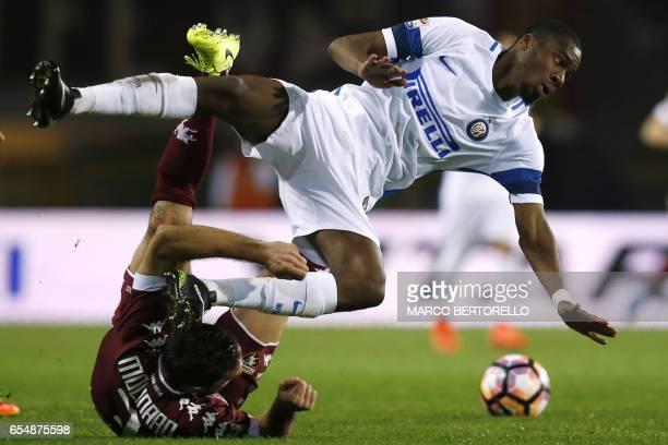 Torino's defender Cristian Molinaro vies with Inter Milan's French midfielder Geoffrey Kondogbia during the Italian Serie A football match Torino vs...