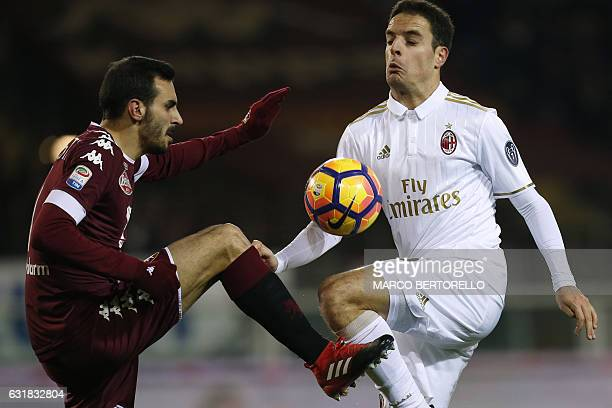 Torino's defender Davide Zappacosta fights for the ball with AC Milan's midfielder Giacomo Bonaventura during the Italian Serie A football match...