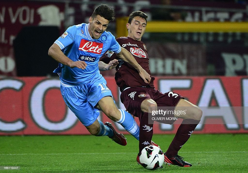 Torino's defender Matteo Darmian (R) fights for the ball with Napoli's midfielder Christian Maggio during the serie A football match between Turin and Naples, on March 30, 2013 in Turin, at the Olympic stadium .