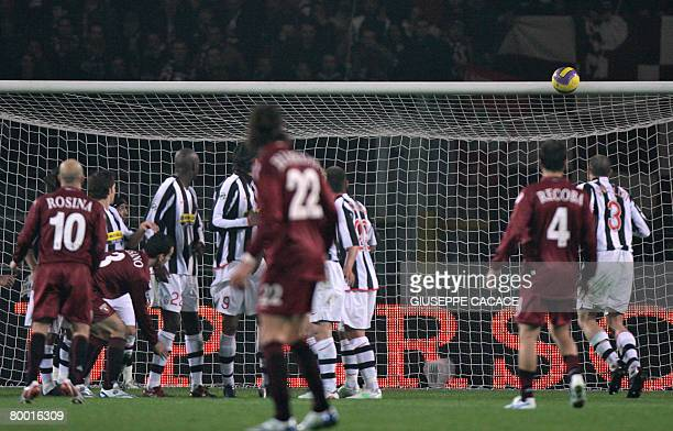 Torino's forward Alessandro Rosina shoots on the cross bar during their 'Serie A' football match against Juventus on February 26 2008 at Olympic...