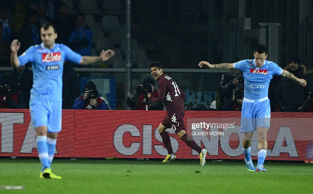 Torino's forward Alessandro Sgrigna (C) celebrates after scoring during the serie A football match between Turin and Naples, on March 30, 2013 in Turin, at the Olympic stadium .