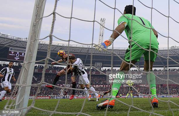 Torino's forward Andrea Belotti scores during the Italian Serie A football match Torino vs Juventus on December 11 2016 at the 'Grande Torino...