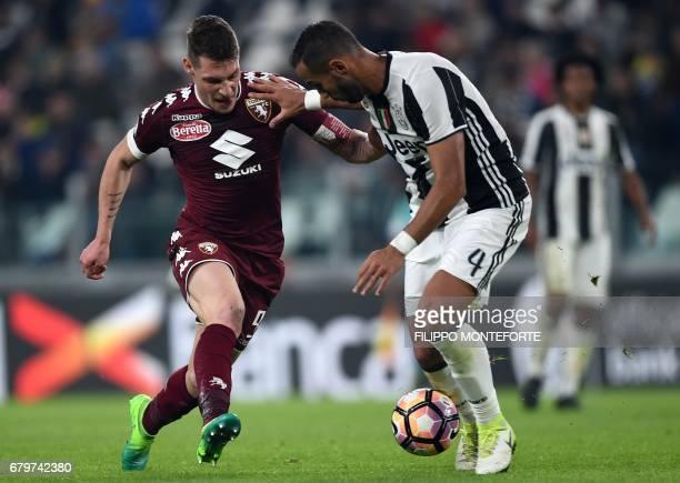 Torino's forward from Italy Andrea Belotti vies with Juventus defender Medhi Benatia during the Italian Serie A football match Juventus vs Torino FC...