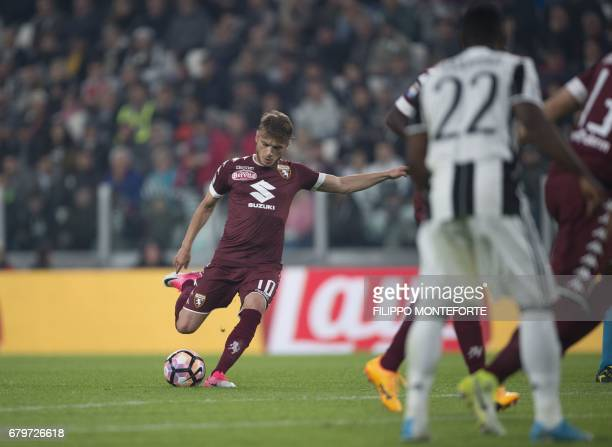 Torino's forward from Serbia Adem Ljajic scores a penalty during the Italian Serie A football match Juventus vs Torino FC at the Juventus stadium in...