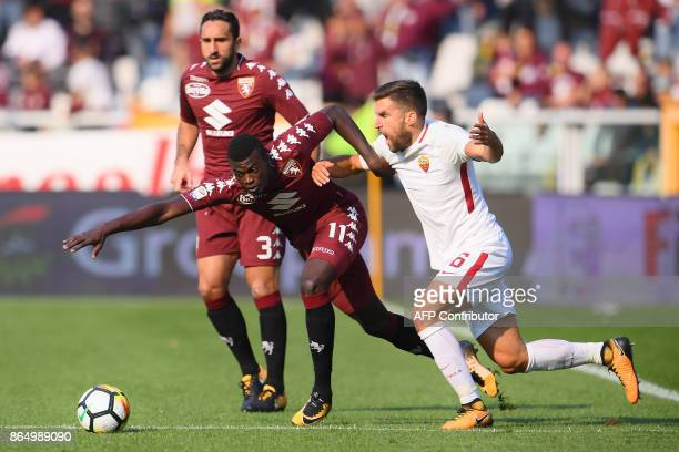 Torino's forward M'Baye Niang from France fights for the ball with AS Roma's midfielder Kevin Strootman from Netherlands during the Italian Serie A...