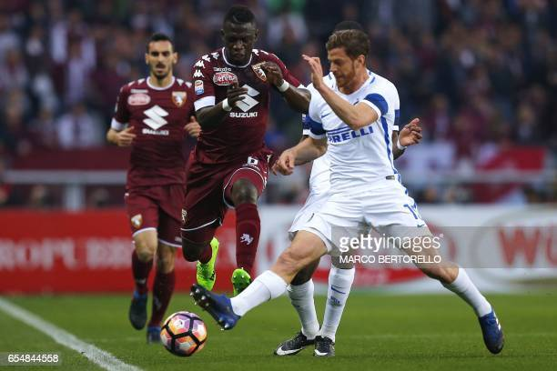 Torino's Ghanan midfielder Afriyie Acquah vies for the ball with Inter Milan's defender Argentinian Cristian Ansaldi during the Italian Serie A...