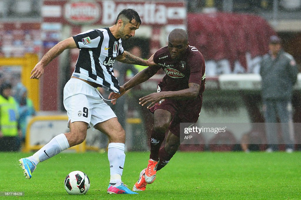 Torino's Italian defender Angelo Obinze Ogbonna (R) vies for the ball with Juventus' Montenegrin forward Mirko Vucinic during the Italian Serie A football match between Torino and Juventus on April 28, 2013 at the Olympic Stadium in Turin.