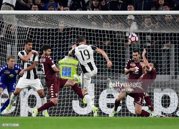 Torino's Italian defender Cristian Molinaro deflects the kick of Juventus' Italian defender Leonardo Bonucci during the Italian Serie A football...