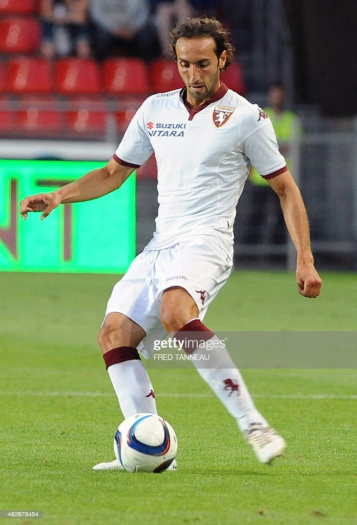Torino's Italian defender <a gi-track='captionPersonalityLinkClicked' href=/galleries/search?phrase=Emiliano+Moretti&family=editorial&specificpeople=653861 ng-click='$event.stopPropagation()'>Emiliano Moretti</a> controls the ball during a friendly football match between Rennes and Torino at Roazhon Park stadium in Rennes, western France, on August 1, 2015.