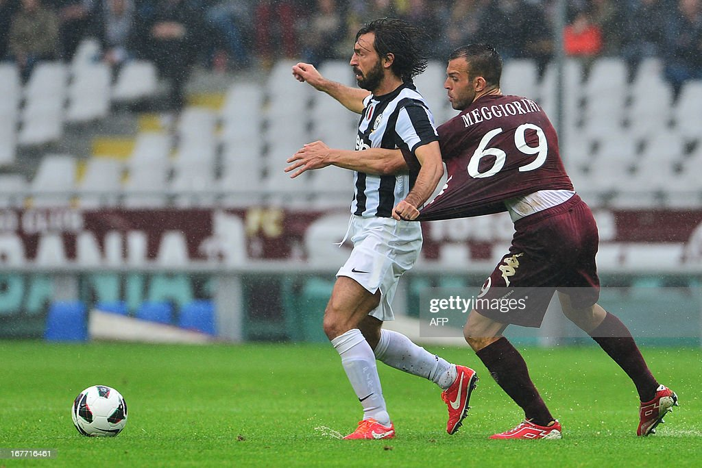 Torino's Italian forward Riccardo Meggiorini (R) vies for the ball with Juventus' Italian midfielder Andrea Pirlo during the Italian Serie A football match between Torino and Juventus on April 28, 2013 at the Olympic Stadium in Turin.