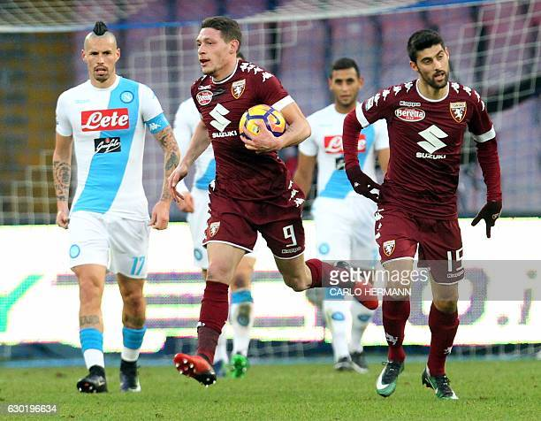 Torino's Italian midfielder Marco Benassi celebrates after scoring a goal with his teammate Italian forward Andrea Belotti during the Italian Serie A...