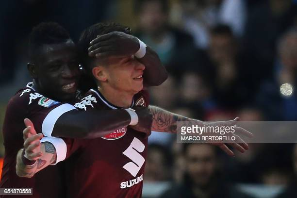 Torino's midfielder Daniele Baselli celebrates after scoring a goal with teammate Ghanan midfielder Afriyie Acquah during the Italian Serie A...