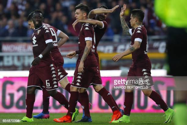 Torino's midfielder Daniele Baselli celebrates with teammates after scoring a goal during the Italian Serie A football match Torino versus Inter...