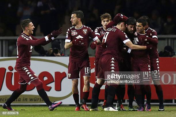 Torino's midfielder Marco Benassi celebrates after scoring with his teammates during the Italian Serie A football match Torino Vs AC Milan on January...