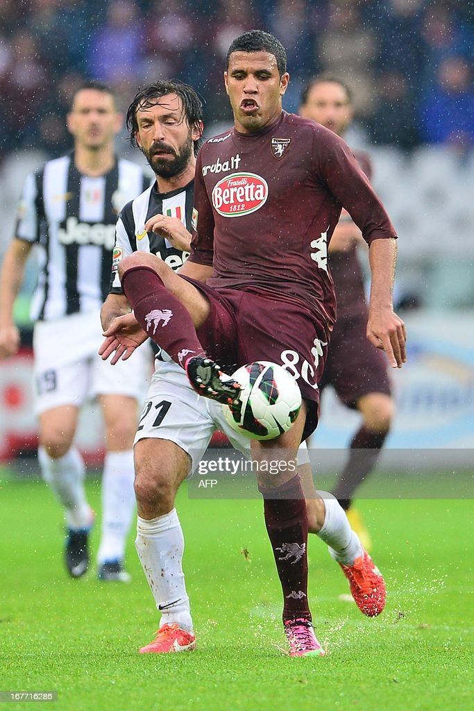 Torino's midfielder Sergiu Suciu (Front) vies with Juventus' midfielder Andrea Pirlo during an Italian Seria A football match between Torino and Juventus at the Olympic Stadium in Turin on April 28, 2013. AFP PHOTO / GIUSEPPE CACACE