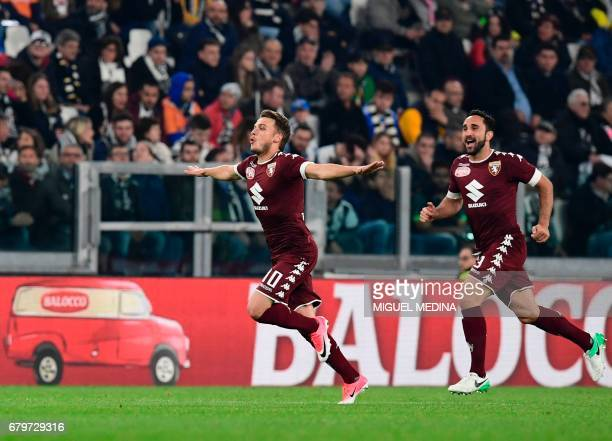 Torino's Serbian forward Adem Ljajic celebrates after scoring during the Italian Serie A football match Juventus vs Torino FC at the Juventus stadium...