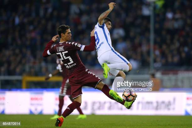 Torino's Serbian midfielder Sasa Lukic vies for the ball with Inter Milan's Argentinian midfielder Ever Banega during the Italian Serie A football...