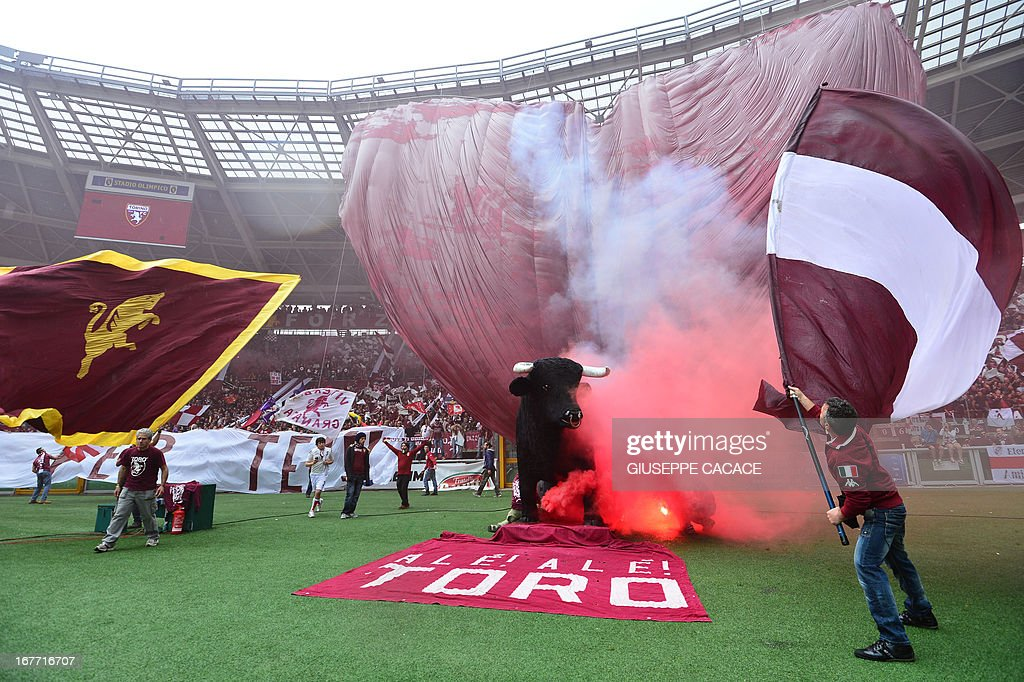 Torino's supporter waves their flags before the Italian Serie A football match between Torino and Juventus on April 28, 2013 at the Olympic Stadium in Turin.
