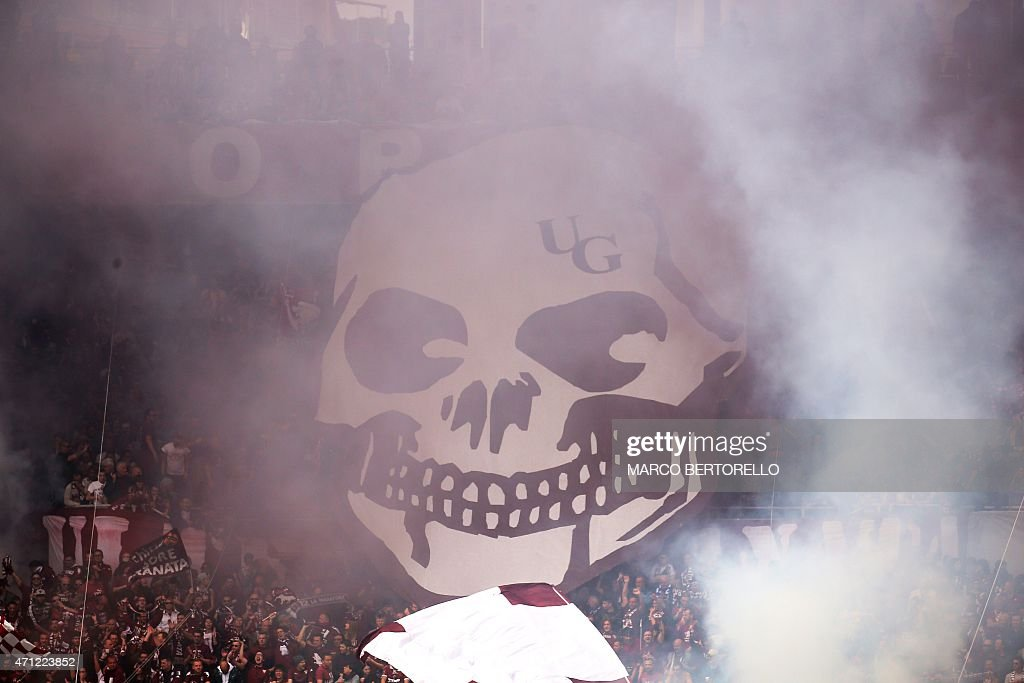 Torino's supporters cheer on their team before the Italian Serie A football match Torino vs Juventus on April 26 2015 at the 'Olympic Stadium' in...