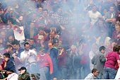 Torino's supporters react after a firework exploded during the Italian Serie A football match Torino vs Juventus on April 26 2015 at the 'Olympic...