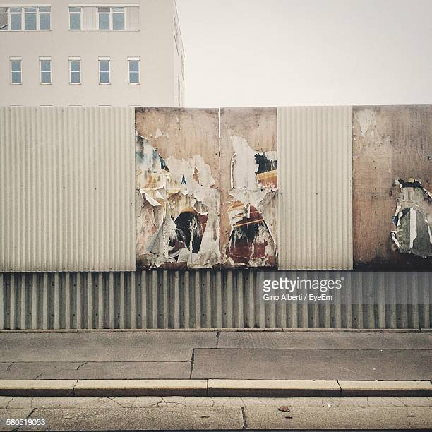 Torn Advertisements On Surrounding Wall