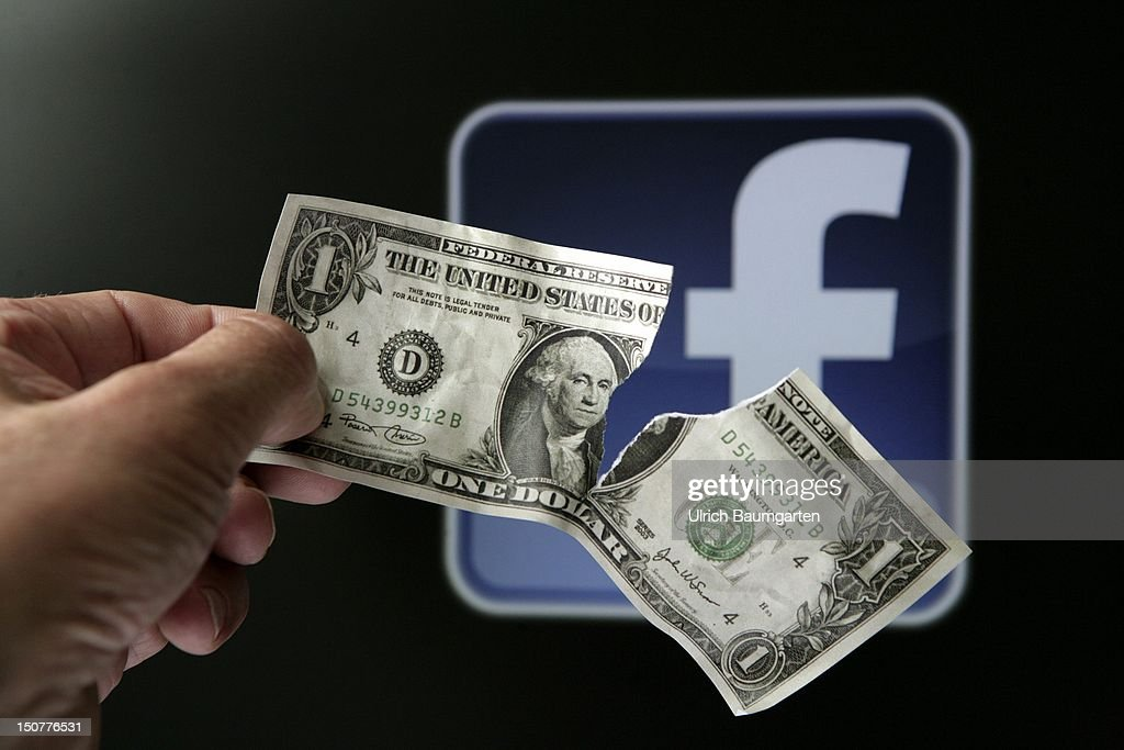 Torn dollar bill in front of the Facebook logo, symbol picture: 'The downward trend continues' - big losses for investors of Facebook shares.