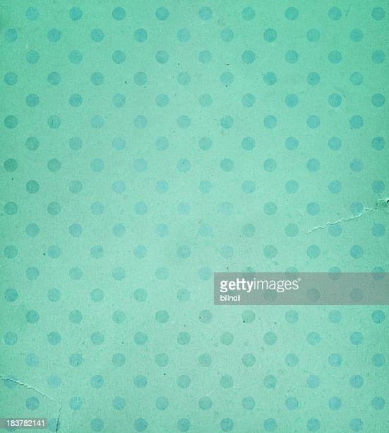 torn green paper with faded dots