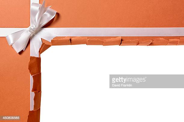 Torn package with gift ribbon
