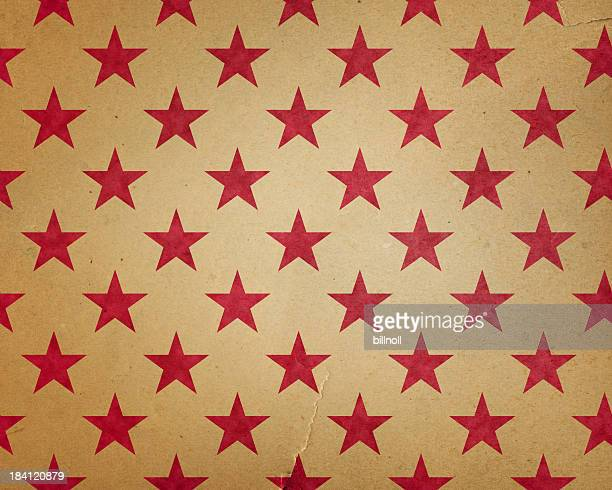 torn paper with red stars