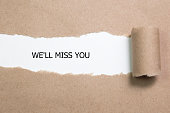 Torn Paper With Text ' We'll Miss You '