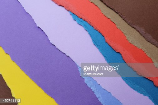 Torn pieces of various colored construction paper arranged into a pattern