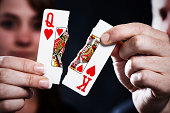 Torn playing cards symbolize divorce