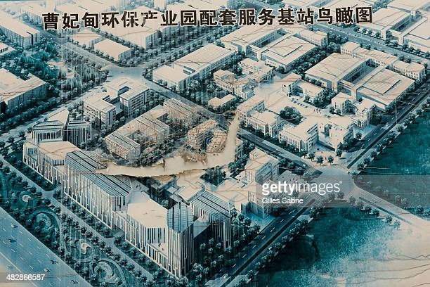 CAOFEIDIAN TANGSHAN HEBEI CHINA A torn poster rendering the 'dream' of Caofeidian Environmental Industries Park The park was never completed and the...