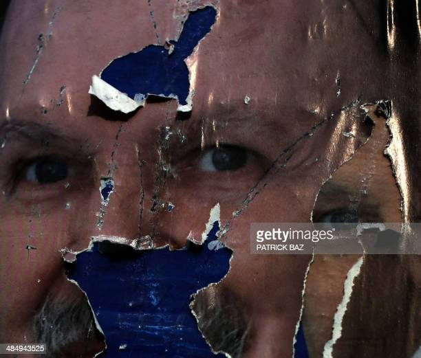 Torn posters of current Algerian president Abdelaziz Bouteflika who is running for reelection appear in the city of Borj alBahri 24km East of the...