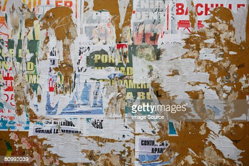Torn posters on wall