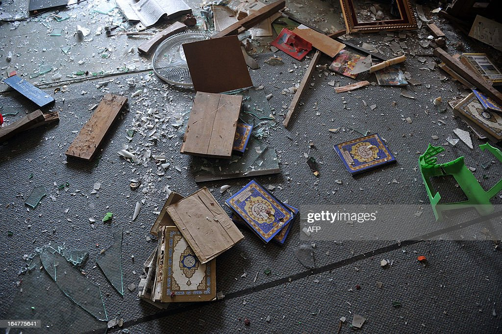 Torn religious books lie on the floor of a partially-destroyed mosque after sectarian violence spread through central Myanmar, in Minhla, Bago division on March 28, 2013. Myanmar's Muslim leaders have appealed to President Thein Sein to take swift action to quell religious violence, accusing security forces of standing by as rioters went on a rampage. AFP PHOTO/Ye Aung THU