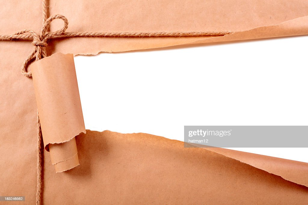 Brown paper package with torn section